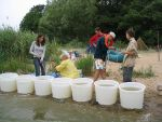 Students investigating water samples in the curonian lagoon.